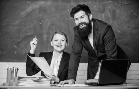 Look at this. teacher and student on exam. businessman and secretary. back to school. Non-formal education. paper work. office life. business couple use laptop and documents. Living in digital age