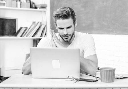 Handsome man use modern technology. Improve knowledge. Student learn programming language. High school and university. Programming web development. Digital technology. Apply online programming course Stock Photo - 135388469