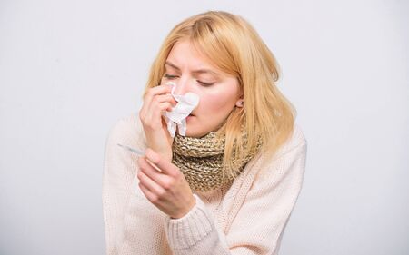 How to bring fever down. Sick girl with fever. Girl sick hold thermometer and tissue. Measure temperature. Break fever remedies. Seasonal flu concept. Woman feels badly. Fever symptoms and causes Фото со стока