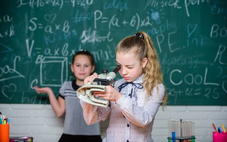 science experiments in laboratory. Biology school lesson. Little girls in school lab. Formal school education. Chemistry research. Little scientist work with microscope. All the research is online