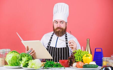 Cooking skill. Book recipes. According to recipe. Man bearded chef cooking food. Check if you have all ingredients. Cook read book recipes. Man learn recipe. Try something new. Cookery on my mind