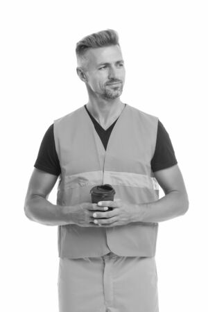Coffee break concept. Builder enjoy coffee. Strong handsome builder hold coffee cup. Successful engineer. Man protective uniform white background. Worker builder confident drinking coffee and relax