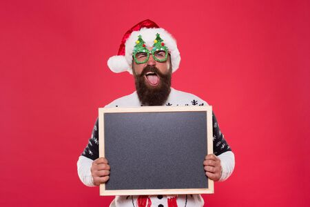 Rental services. Winter price drop. Bearded hipster Santa claus. Joyful man show blackboard copy space. Happy winter holidays. Presentation announcement. Promoting winter goods. Profitable offer here