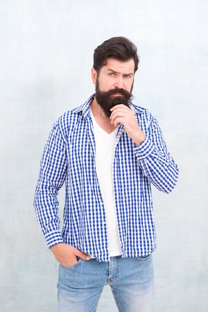 Male casual fashion style. barber care for real men. brutal hipster with mustache. Mature hipster with beard. confident in his style. Bearded man seriously tuned. Denim look 版權商用圖片