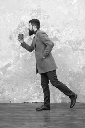 Style in motion. Man handsome bearded businessman hold cup of coffee. Coffee break concept. Business people fashion style. Smart casual style clothes for office life. Best coffee served for him