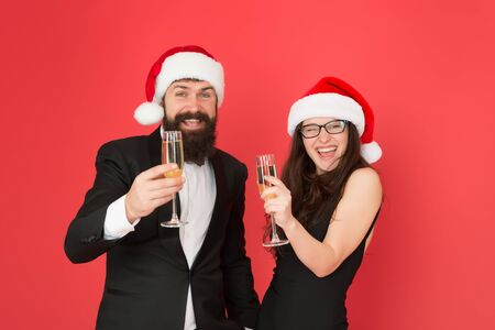 Are you ready. business couple drink champagne. xmas office party. they love new year. greetings concept. formal couple visiting event ceremony. tuxedo man with woman in santa hat. merry christmas