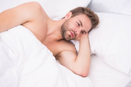 Time for relax. Relax techniques. Perfect rest. Man handsome guy relax in bed. Get enough amount of sleep. Tips sleeping better. Unshaven man handsome face relaxing. Pleasant relaxation concept Banco de Imagens