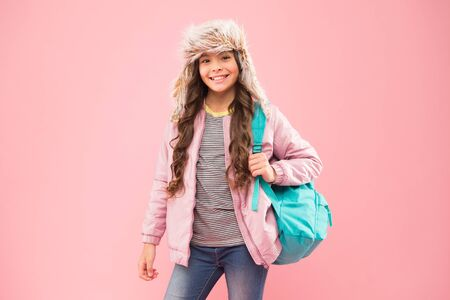 Hipster style. Modern backpack for daily life. Teen fashion. Schoolgirl street style clothes with cute backpack. Fit backpack correctly. Girl fashionable cutie carry backpack. Winter semester