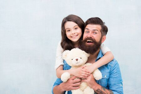 Teddy bear family member. Family relations. Fathers day concept. Lovely father and kid. Father and daughter light background. Strengthening father daughter relationships. Child and dad best friends