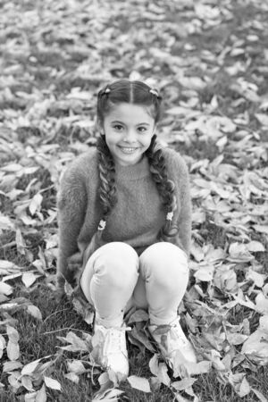 Happy little girl in autumn forest. Autumn leaves and nature. Happy childhood. School time. Small child with autumn leaves. I would stay here forever. Quit morning. Lucky to start the day here Standard-Bild