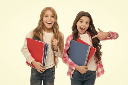 Happy to be students. School supplies concept. We love study. School stationery. Pupils carrying big textbooks to school classes. Taking extra classes. Girls with school textbooks white background