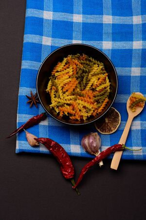 delicious colorful italian pasta with different ingredients for cooking