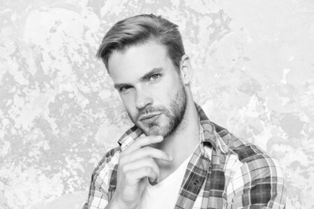 look like know everything. charismatic student checkered shirt. unshaven man care his look. mens sensuality. guy casual style. macho man grunge background. male fashion spring collection