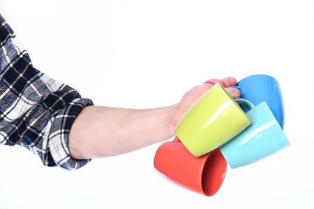 guy hand holding colorful cups