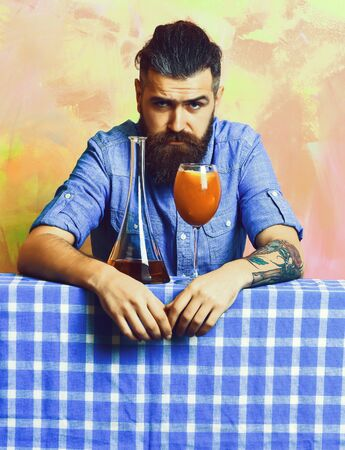 Brutal caucasian hipster with alcohol cocktail and flask Stock fotó