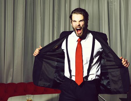 bearded angry man, businessman in suit and red tie Stock fotó