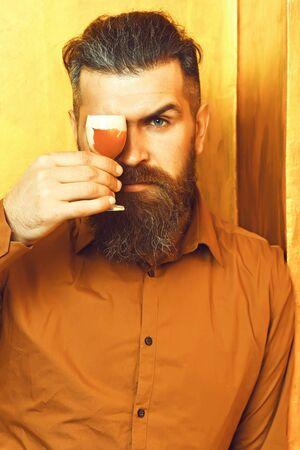 Brutal caucasian hipster holding alcoholic shot Stock fotó