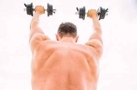 fit your body and lose weight. athletic body. Dumbbell gym. fitness and sport equipment. man sportsman weightlifting. steroids. Muscular back man exercising in morning with barbell. Perfect day