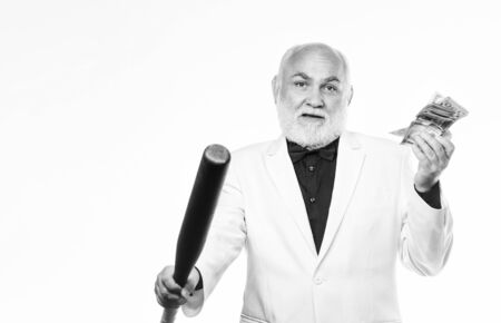 mature bearded man with dollar banknotes and baseball bat. dirty business. successful businessman. Richness. criminal and robbery. debt pit. rich mature man has lots of money. Concept of dirty money