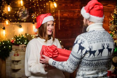 Romantic feelings. Couple in love enjoy christmas holiday celebration. Generous Santa claus. Winter romance. Family tradition. Surprise. Christmas time. Loving couple christmas tree background