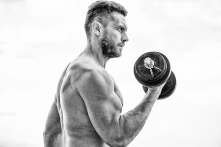 Price of greatness is responsibility. Sportsman with strong torso. Gym equipment. Fitness and bodybuilding sport. Gym workout concept. Dumbbell exercise gym. Muscular man exercising with dumbbell