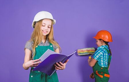 Child care development. Tools to improve yourself. Repair. Future profession. small girls repairing together in workshop. Builder engineer architect. Kid worker in hard hat. children development