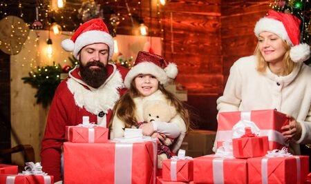 Christmas memories. Happy moments. Girl at home on christmas eve. Adopting child. Kid celebrate new year with pile of gifts. Christmas traditions. Charity and kindness. To do good. Feeling loved Stock fotó