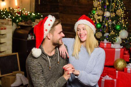 Loving couple christmas tree background. Couple in love enjoy christmas holiday celebration. Boyfriend and girlfriend lovely family celebrate winter holiday. Holiday that is celebrated around world Stock fotó