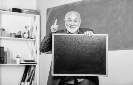 just inspired. exam and graduation results. place for copy space. Mature teacher man hold chalk board. information is here. senior man teacher with empty blackboard. back to school. Education concept Stock fotó