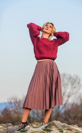 Messy chic style. Gorgeous lady feeling cozy in woolen sweater. Trendy clothes. Woman warm sweater nature background defocused. Elegance concept. Fancy girl makeup face wear knitted sweater Stock fotó