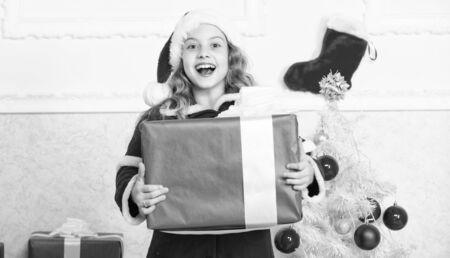 Enjoy christmas holidays. Child red santa costume ready to celebrate. Merry christmas and happy new year. Christmas tradition holiday. Top christmas celebration ideas. Winter holidays concept Stock fotó