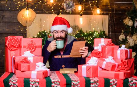 Christmas is here. bearded man santa. Greetings to relatives. winter shopping sales. Writing wish list. christmas gift delivery. bearded santa deliver gifts by address. happy new year. Xmas gifts Stock fotó