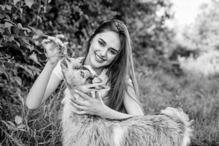 Woman and small goat green grass. Village animals. Girl play cute goat. Feeding animal. Protect animals. Veterinarian occupation. Eco farm. Love and care. Animals law. Farm and farming concept