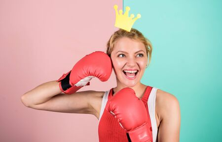 Athletic woman winner. Victory concept. Sport success. Achieve success. Celebrate success. Queen of boxing ring. Sportswoman with princess crown. Cheerful girl with crown prop in boxing gloves
