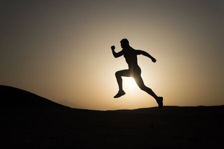 Never stop. Silhouette man motion running in front of sunset sky background. Future success depends on your efforts now. Daily motivation. Healthy lifestyle personal achievements goals and success.