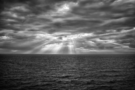 Cloudscape with sunrays over sea in London, United Kingdom. Sea on cloudy sky. Clouds on dramatic sky. Evening nature and sunset. Freedom and wanderlust concept.
