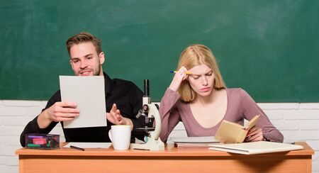 Studying in college or university. Friends students studying university. College fun. Modern education. Having fun in college. Carefree students. Enjoying time in college. Guy and girl sit classroom