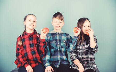 Having tasty snack. School snack time. Boy and girls friends eat apple snack. Teens with healthy snack. Apple fruit has numerous benefits. Vitamin nutrition concept. Eat fruit and be healthy Stock fotó