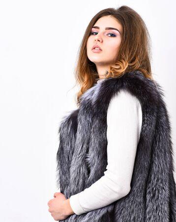 Fashion trend concept. Winter fashionable wardrobe for female. Silver fur vest fashion clothing. Boutiques selling fur. Woman makeup face wear fur vest white background. Luxury fur accessory clothes Stock fotó