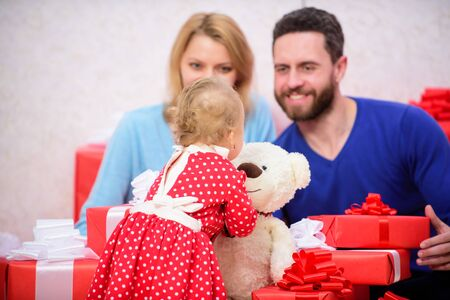 Love and trust in family. Bearded man and woman with little girl. Shopping online. father, mother and doughter child. Happy family with present box. Valentines day. Red boxes. Love is a great feeling Stock fotó