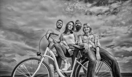 Share or rental bike service. Group friends hang out with bicycle. Bicycle as best friend. Company stylish young people spend leisure outdoors sky background. Cycling modernity and national culture