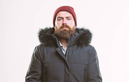 Hood adds warmth and weather resistance. Man bearded stand warm jacket parka isolated on white background. How to choose best winter jacket. Weather resistant jacket concept. Winter season menswear Stock fotó