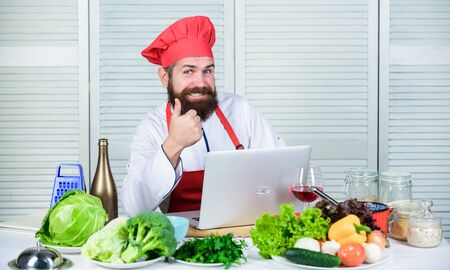 Healthy food cooking. Mature hipster with beard. Happy bearded man. chef recipe. Cuisine culinary. Vitamin. Vegetarian salad with fresh vegetables. Dieting organic food. Hip and stylish Stock fotó