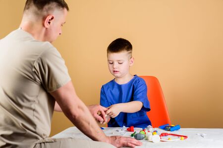 childhood. parenting. family doctor. happy child with father with stethoscope. medicine and health. father and son in medical uniform. small boy with dad play. Future career. nice to spend time. Stock fotó