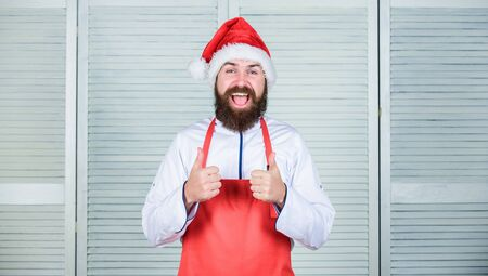 Last minute christmas dinner idea. Simple recipe with little active cooking time. Man santa hat bearded hipster wear culinary apron. Cooking dish for family. Cooking delicious and quick holiday meal