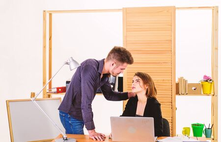 Falling in love in office. Workplace romance of handsome man and sexy woman in office. Couple in love conducting affair at workplace. Female and male colleagues dating at workplace. Workplace affair Stock fotó