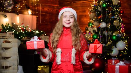 Congratulating her nearest. Little girl in red hat. Shopping day. Elf child. Xmas tree. Holiday shopping. Santa claus little girl. Christmas shopping. Christmas time. Shopping sale. Happy new year