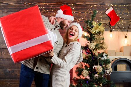Giving happiness. Generous giver. Preparing presents for christmas. Winter happiness. Happy and satisfied. Santa Claus. Man and woman with gift box. Smiling guy with giant present. Spread happiness