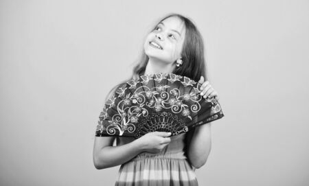 Acting school. Dances with fan. Girl fanning herself with fan. Air circulation. Art and culture. Handheld fan create airflow. Airflow from handfans increases evaporation. Cooling effect. Folding fans Stock fotó