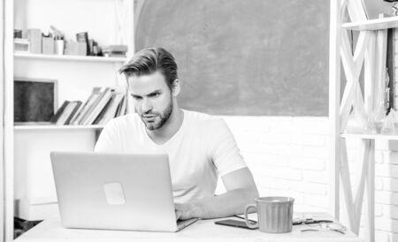Handsome man use modern technology. Improve knowledge. Programming web development. Digital technology. Apply online programming course. Student learn programming language. High school and university Stock fotó